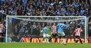 Manchester City's Yaya Toure (left) scores the first against Sunderland Photograp:  Nick Potts/PA Wire