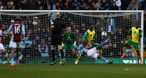 Aston Villa's Christian Benteke scores his first against Norwich City at Villa Park, Birmingham. Photograph: Peter Byrne/PA Wire