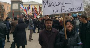 "Viktor and Yelena Vesna at a pro-Russian protest in Simferopol, Crimea. Their placard says: ""The Maidan – is like Egypt!"" Photograph: Daniel McLaughlin"