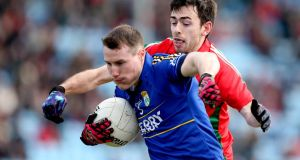 Kerry's Mark Griffin holds off Mayo's Kevin McLoughlin at MacHale Park, Castlebar yesterday. Photo: James Crombie/Inpho