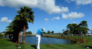 Rory McIlroy tees off on the ninth hole during the final round of The Honda Classic at PGA National in Palm Beach Gardens, Florida. Photograph: Stuart Franklin/Getty Images