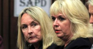 June Steenkamp (L), mother of the murdered Reeva Steenkamp, sits in court ahead of the trial of  Oscar Pistorius at the North Gauteng High Court in Pretoria. Photograph: Themba Hadebe/Pool /Reuters