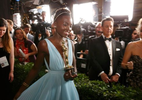 Lupita Nyong'o with her award for best supporting actress for her role in 12 Years a Slave. Photograph: Adrees Latif/Reuters