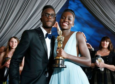 Lupita Nyong'o with her Oscar and her brother Julian Nyong'o at the Governors Ball after the awards. Photograph: Adrees Latif/Reuters