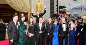 Actor Benedict Cumberbatch jumps behind U2 at the 86th Academy Awards. Photograph: Mike Blake/Reuters