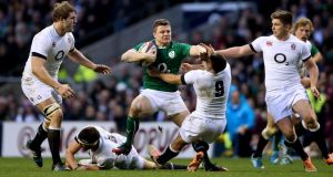 Ireland's Brian O'Driscoll hands off Danny Care of England at Twickenham last month. Photograph: James Crombie/Inpho