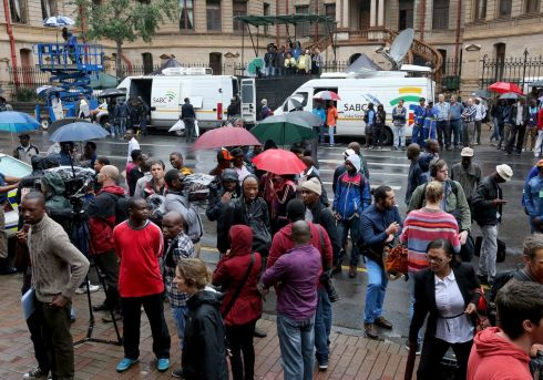 Members of the media stand outside  North Gauteng High Court in Pretoria, South Africa, as Oscar Pistorius (27) slips into court through another door to face trial accused of the murder of his girlfriend Reeva Steenkamp.  The Olympic and Paralympic athlete denies the allegation claiming he mistook Steenkamp for an intruder inside their home on Valentine's Day 2013. Photograph: Christopher Furlong/Getty Images
