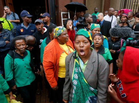 Members of the African National Congress Women's League sing in front of the court house ahead of the trial. Photograph: Mike Hutchings/Reuters