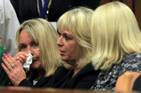 June Steenkamp, mother of Reeva Steenkamp (l) with unidentified women sits inside the high court in Pretoria. Photograph: Themba Hadebe/EPA