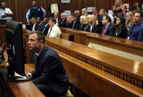 Oscar Pistorius sits in court ahead of his trial. Photograph: Themba Hadebe/EPA/Pool