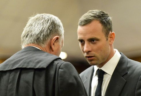 The athlete speaks with his lawyer Barry Roux. Photograph: Herman Verwey/EPA