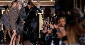 Cara Delevingne and Joan Smalls present creations by British designer Stella McCartney. Photograph: Benoit Tessier/Reuters