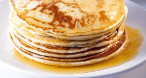 There is a visual allure to a stack of thick American pancakes.