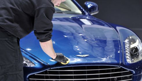 Elbow grease on an Aston Martin hood. A perfect fit. Photograph: Harold Cunningham/Getty Images