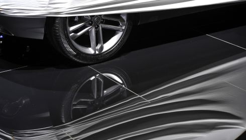 Sweeping lines: An Opel hides ahead of its unveiling. Photograph: Harold Cunningham/Getty Images