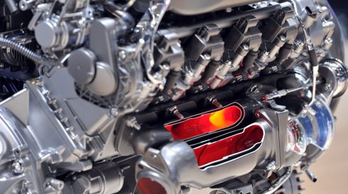 More science: A Mercedes-Benz engine has cutaways with orange lights inside. It's an education. Photograph: Harold Cunningham/Getty Images