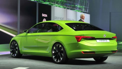 Skoda Auto chairman Winfried Vahland presents the new Skoda Vision C concept car, in lurid green.  Photograph: Harold Cunningham/Getty Images