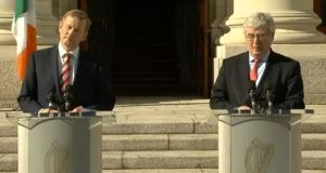Taoiseach Enda Kenny and Tánaiste Eamon Gilmore present their progress report at a press conference at Government Buildings this afternoon. Photograph: RTE.ie
