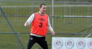 John O'Shea takes part in the Republic of Ireland squad training session at Malahide this morning. Photograph: Donall Farmer/Inpho