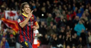 Barcelona's Carles Puyol celebrates scoring against Almeria last weekend. Photograph: Albert Gea/Reuters
