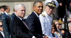 Robert Gates with Barack Obama and Admiral Mike Mullen at a Gates farewell ceremony. Photograph: Jason Reed/Reuters