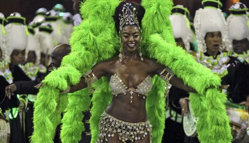 Apparently these types of carnival outfits are one big parade cliche. Like leprechauns on this side of the water. Photograph: Antonio Lacerda/EPA
