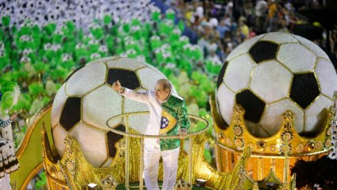 Brazil's former national soccer player Rivelino rides atop a float from the Imperatriz Leopoldinense samba school. So, is this a nod to what's happening in Brazil later this year? Photograph: Ricardo Moraes/Reuters