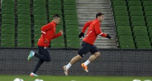 Serbia's Aleksander Kolarov and Branislav Ivanovic during training  at the Aviva Stadium yesterday. Photograph: Donall Farmer/Inpho