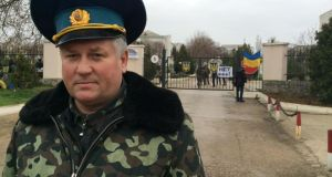 "Col Vladimir Kukharenko: claimed  Russian soldiers at Belbek airbase in the Crimea had ""no insignia on their uniforms""."