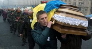 Mourners carry the coffin of Volodymyr Topij, one of protesters that clashed with police at Kiev's Independence Square, during his funeral in the city yesterday. Photograph: Tyler Hicks/The New York Times