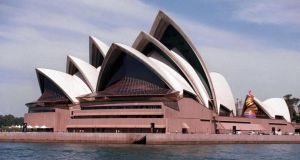 Sydney Opera House is among 136 sites that would be affected if current global temperatures rise three degrees in the next 2,000 years, according to new research. Photograph: AP Photo/Russell McPhedran