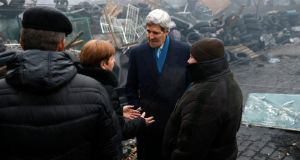US secretary of state John Kerry stands beside a barricade at the Shrine of the Fallen in Kiev yesterday. Photograph: Reuters/Kevin Lamarque