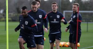 England's Ashley Cole leads players during training including new player Luke Shaw (rear) for tonight's friendly against Denmark at Wembley.
