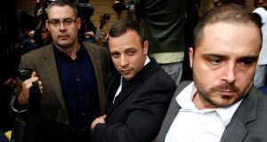 Oscar Pistorius (centre) leaves North Gauteng High Court in Pretoria yesterday. Photograph: Reuters/Siphiwe Sibeko