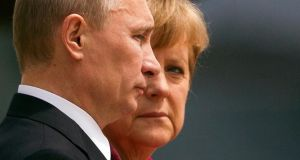 "German chancellor Angela Merkel with Russian president Vladimir Putin in 2012. During a weekend of telephone diplomacy, Merkel told Putin he had ""breached international law with his unacceptable intervention in the Crimea"". Photograph: Reuters/Thomas Peter"