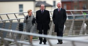 Former US president Bill Clinton walks with former SDLP leader John Hume and his wife Pat across Derry's Peace Bridge today. Photograph: Paul McErlane