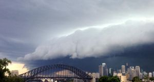 A large storm cloud covers the Sydney CBD today. Photograph: Matt Blyth/Getty Images