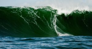 New Yorker Kurt Rist catches a wave at Prowlers, off the coast of Co Sligo, on Monday.  Photograph: Aaron Pierce