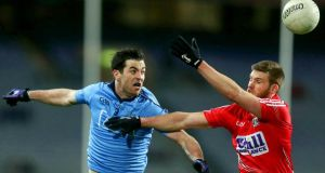 Dublin's Michael Darragh McAuley and Cork's  Eoin Cadogan in action at Croke Park on Saturday night. Photograph: Inpho/Donall Farmer