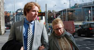 Lucas Neville and his mother  Michelle Neville outside the High Court in Dublin yesterday. Photograph: Gareth Chaney/Collins