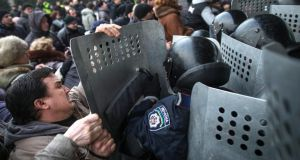 Pro-Russian protesters clash with riot police outside the regional parliament building in Donetsk, Ukraine today. Photograph: Uriel Sinai/The New York Times