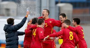The Montenegro under-21 side celebrate after their 2-1 victory over the Republic of Ireland at Tallaght Stadium. Photograph: Dan Sheridan/Inpho
