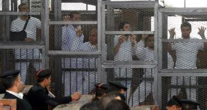 Journalists   stand in a court cage in Cairo yesterday during their trial for allegedly supporting a terrorist group and spreading false information. Photograph: EPA/Tarek Wajeh/Almasry Alyoum