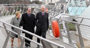 Pat Hume with her husband and former SDLP leader John Hume and Bill Clinton walk across the Peace Bridge. Photograph: Jonathan Porter