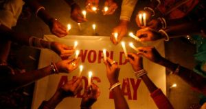 File photograph of people suffering from HIV/AIDS holding candles for   World AIDS Day. Photograph:Rupak De Chowdhuri /Reuters