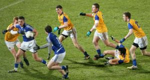 Action from Wednesday night's clash between Laois and Longford. Photograph: James Crombie/Inpho