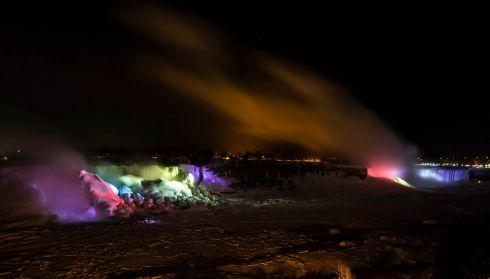 The American Falls and the Horseshoe Falls (right) are seen partially frozen lit by lights during sub freezing temperatures this week. Photograph: Mark Blinch/Reuters