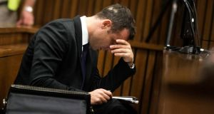 Oscar Pistorius looks at notes during the fourth day of his trial for the murder of his girlfriend Reeva Steenkamp at the North Gauteng High Court in Pretoria, today. Reuters