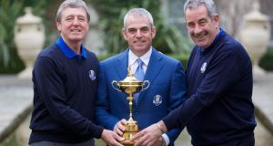 Paul McGinley, European Ryder Cup caption, is pictured with his vice-captains Des Smyth and Sam Torrance during a press conference in Dublin yesterday. Photograph: Patrick Bolger/Getty Images)