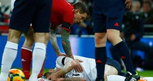 England's Jack Wilshere (bottom) reacts after being fouled by Denmark's Daniel Agger  during their international friendly soccer match at Wembley Stadium. Photograph: Eddie Keogh/Reuters.
